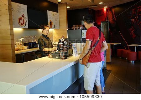 SHENZHEN, CHINA - OCTOBER 09, 2015: McCafe interior. McCafe is a coffee house style food and drink chain, owned by McDonald's.