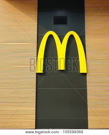 SHENZHEN, CHINA - OCTOBER 09, 2015: McDonald's restaurant logo. McDonald's primarily sells hamburgers, cheeseburgers, chicken, french fries, breakfast items, soft drinks, milkshakes, and desserts