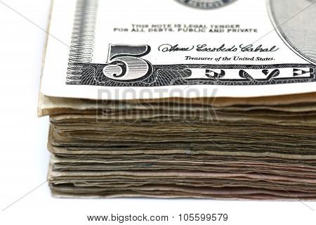 A Stack Of Five Dollar Bills Isolated On A White Background