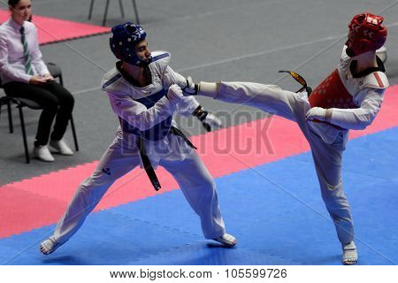 ST. PETERSBURG, RUSSIA - OCTOBER 17, 2015: Unidentified athletes compete in the individual taekwondo tournament during the martial arts festival Baltic Sea Cup in Sibur Arena