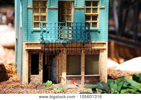 Details of a houses near miniature railroad, set in a public park