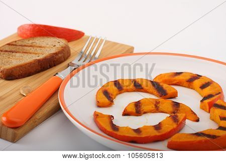 Grilled Pumpkin Hokkaido With Toasted Bread On White
