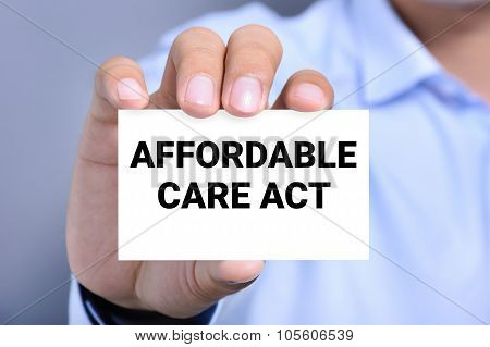 Affordable Care Act (or Aca) Message On The Card Shown By A Man
