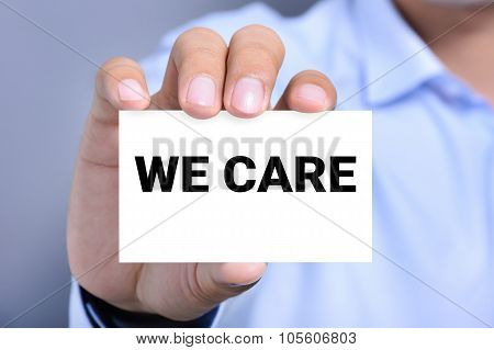 We Care, Message On The Card Shown By A Man