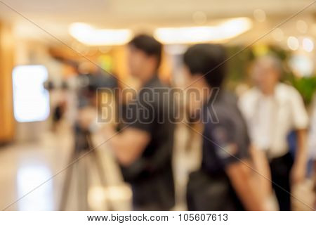 Blurred Photo Of Photographer On Duty In In Press Conference Event, Business Concept.