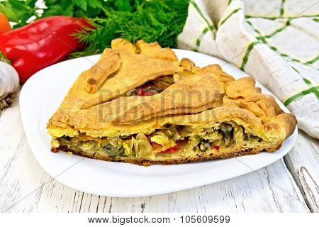 Pie With Cabbage And Sorrel In Plate On Board