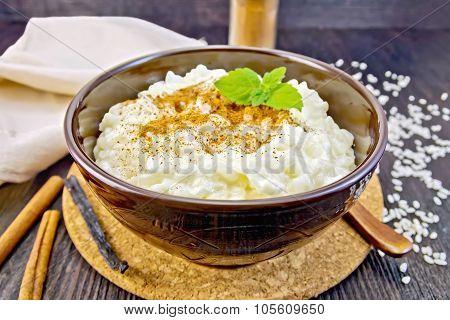 Rice Porridge With Cinnamon In Bowl On Board
