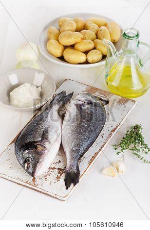 Fresh Raw Dorado Fish With Vegetables