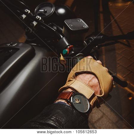 Close-up Of Hand Of Motorcyclist In Protective Glove