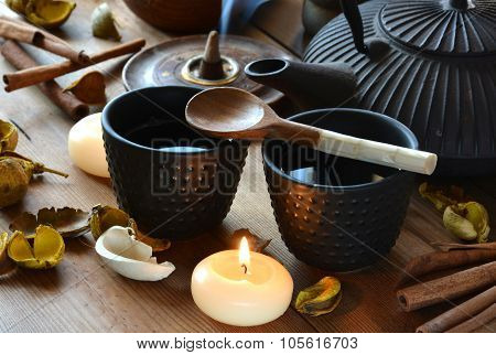 Cups Of Black Tea Accompanied By Incense