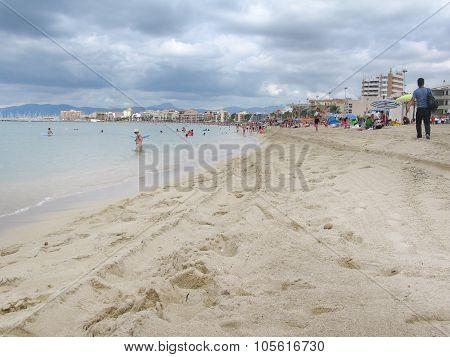 Summer beach life with dark cloud