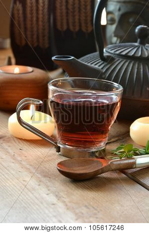 Cups Of Red Tea Accompanied By Incense