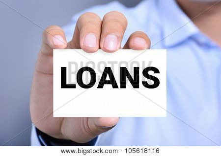 Loans Word On The Card Held By A Man Hand