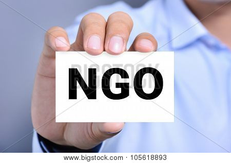 Ngo Letters (or Non-governmental Organization) On The Card Shown By A Man