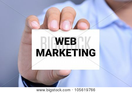 Web Marketing Message On The Card Shown By A Man