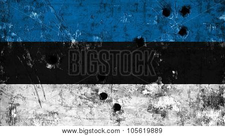 Flag of Estonia, Estonian flag painted on wall with bullet holes.