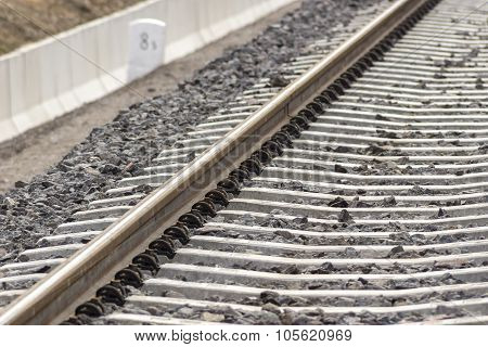 Train Tracks At A New Station Platforms