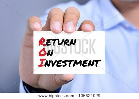 Return On Investment (or Roi) Message On The Card Shown By A Man