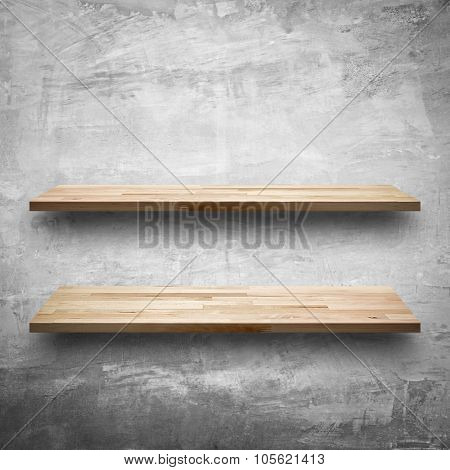 Empty Wooden Shelves On Bare Concrete Wall Background