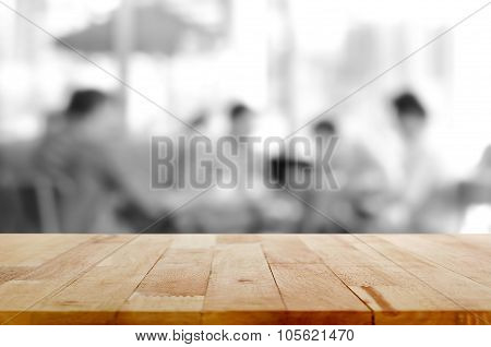 Wood Table Top With Blurred Monochrome Background Of People In Cafe