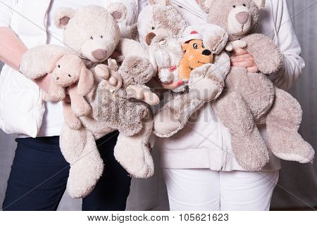 Female Helpers Offer Toys To Refugee Children