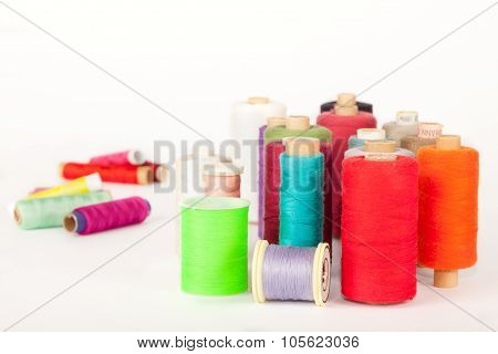 Bobbins of colorful threads