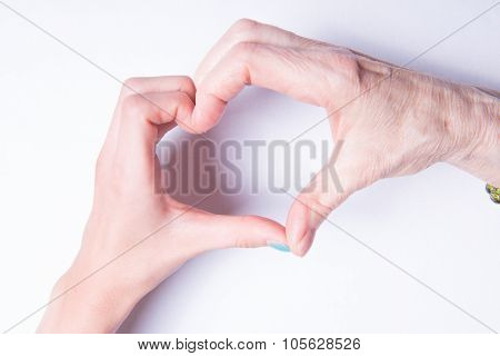 Grandmother's And Children's Hands Form Heart