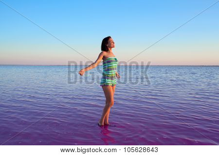 Girl Standing In Water Of Pink Salted Lake In Altai