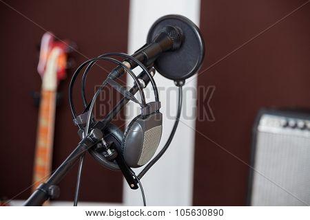 Closeup of headphones on microphone in recording studio
