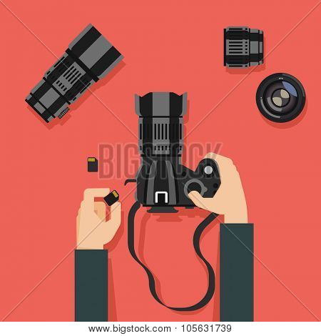 Flat design vector illustration of hands with camera and photography equipment
