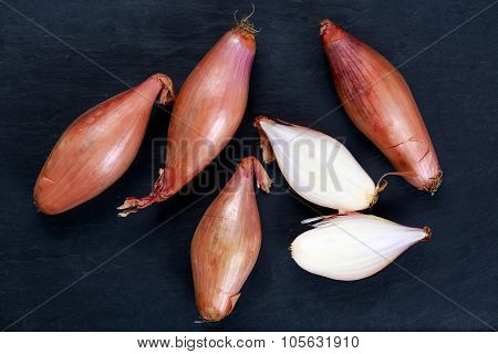 Close up Raw Organic Onion Shallots whole and slices.  Background