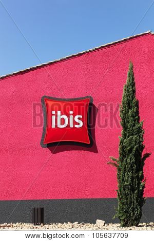 Ibis hotel sign on a red wall