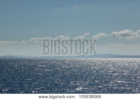 Coastline Of Sardinia With Several Sailing Boats In Sunshine