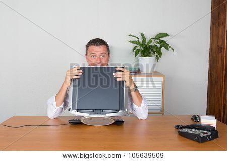 Business man holding his screen