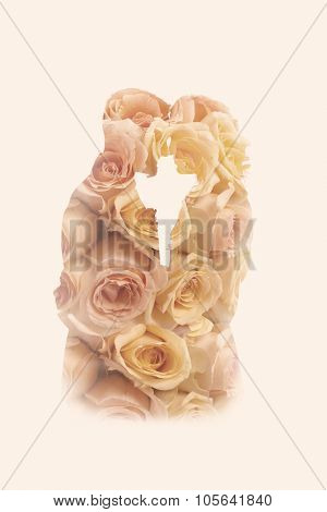 Double exposure portrait of a wedding couple combined with roses from the wedding bouquet
