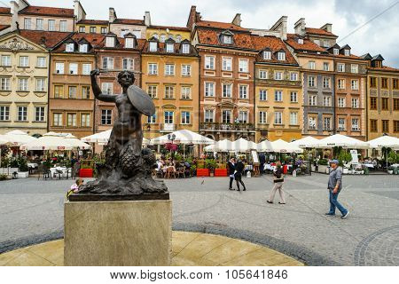 Warsaw, Poland - 8 March 2015:  mermaid statue on the Market square background in Warsaw in Poland