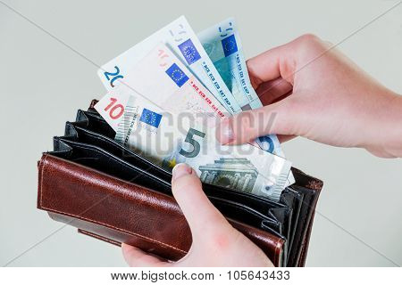 in a purse there are several euro banknotes.