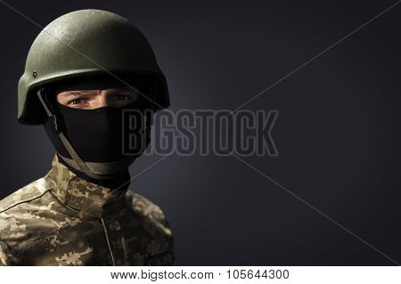 Portrait Of Soldier On Dark Background With Space For Text