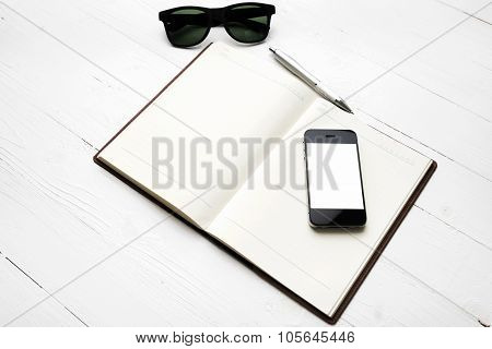 Cellphone With Notebook And Sunglasses