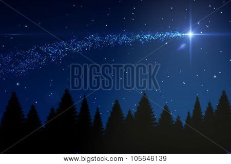 Digitally generated Shooting star over forest at night