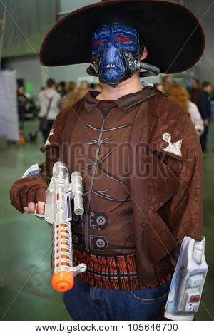 MOSCOW - OCT 12, 2014: The man cosplayer in a blue mask and hat at the EveryCon 2014 in the exhibition center Sokolniki