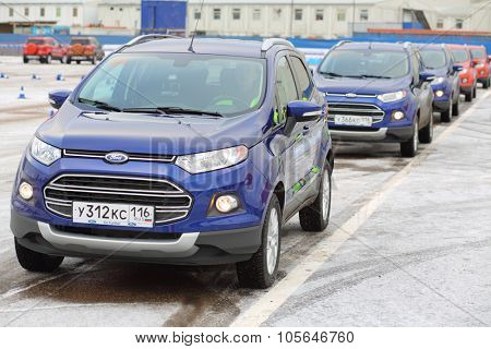MOSCOW - DEC 05, 2014: Row of new cars at the opening of the Academy of safe driving Ford in Moscow