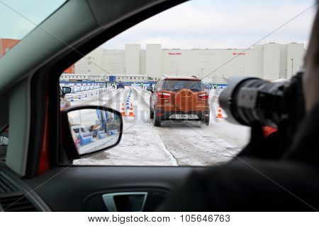MOSCOW - DEC 05, 2014: Taking pictures from the car window at the opening of the Academy of safe driving Ford in Moscow