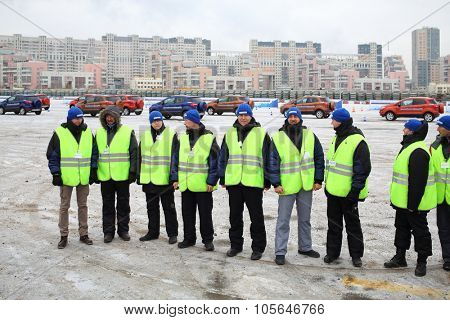 MOSCOW - DEC 05, 2014: Nine professional driving instructors on site of the Academy of safe driving Ford in Moscow