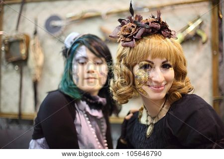MOSCOW - OCT 12, 2014: Portrait of two cosplayers with fantasy makeup at the EveryCon 2014 in the exhibition center Sokolniki