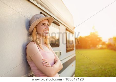 Beautiful woman outside the camper van