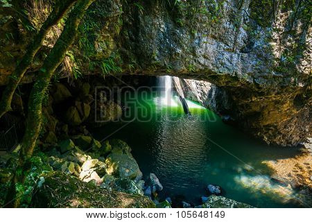 The Natural Bridge waterfall at Springbrook National Park in Queensland Australia