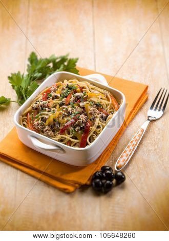 spaghetti with tuna capers olives and peppers, selective focus