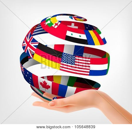 Flags of the world on a globe, held in hand. Vector illustration.