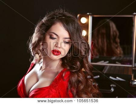 Beauty Fashion Makeup. Dressing Room. Beautiful Brunette Girl With Red Lips In Sensual Dress Posing